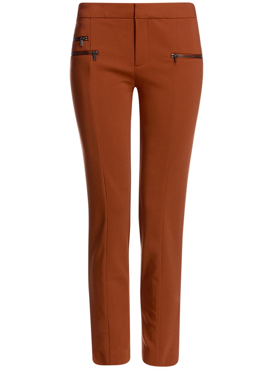 Брюки11706194/35589/3700NСтильные женские брюки oodji Ultra выполнены из качественного комбинированного материала. Модель со средней посадкой застегивается на молнию, пуговицу и застежку-крючок. Спереди изделие оформлено тремя декоративными молниями. Низ брючин дополнен небольшими разрезами.