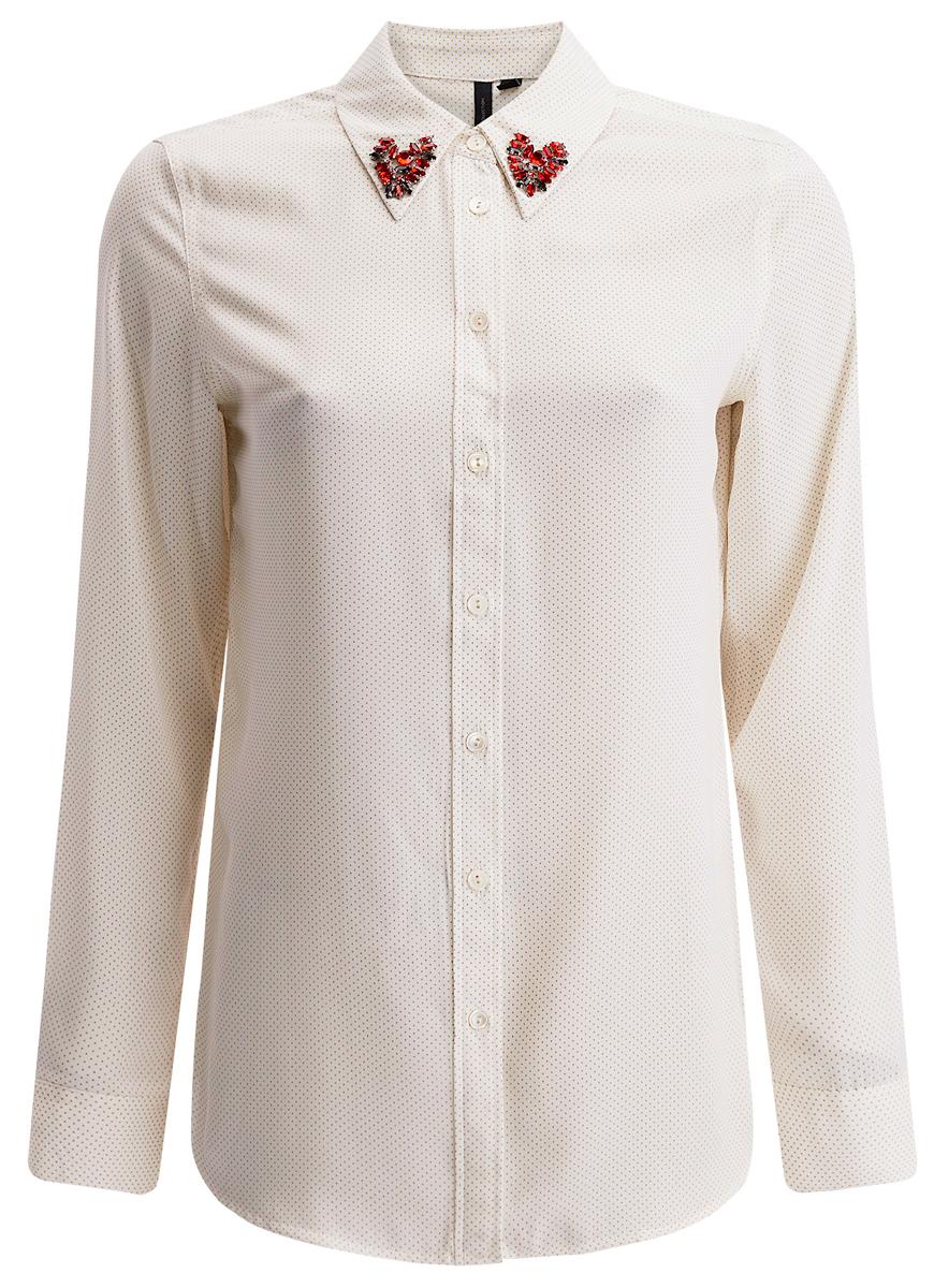 Блузка21411097/43414/2900NСтильная женская блузка oodji Collection выполнена из 100% полиэстера. Модель с отложным воротником и длинными рукавами застегивается на пуговицы. Спинка модели удлинена. Воротник декорирован стразами.