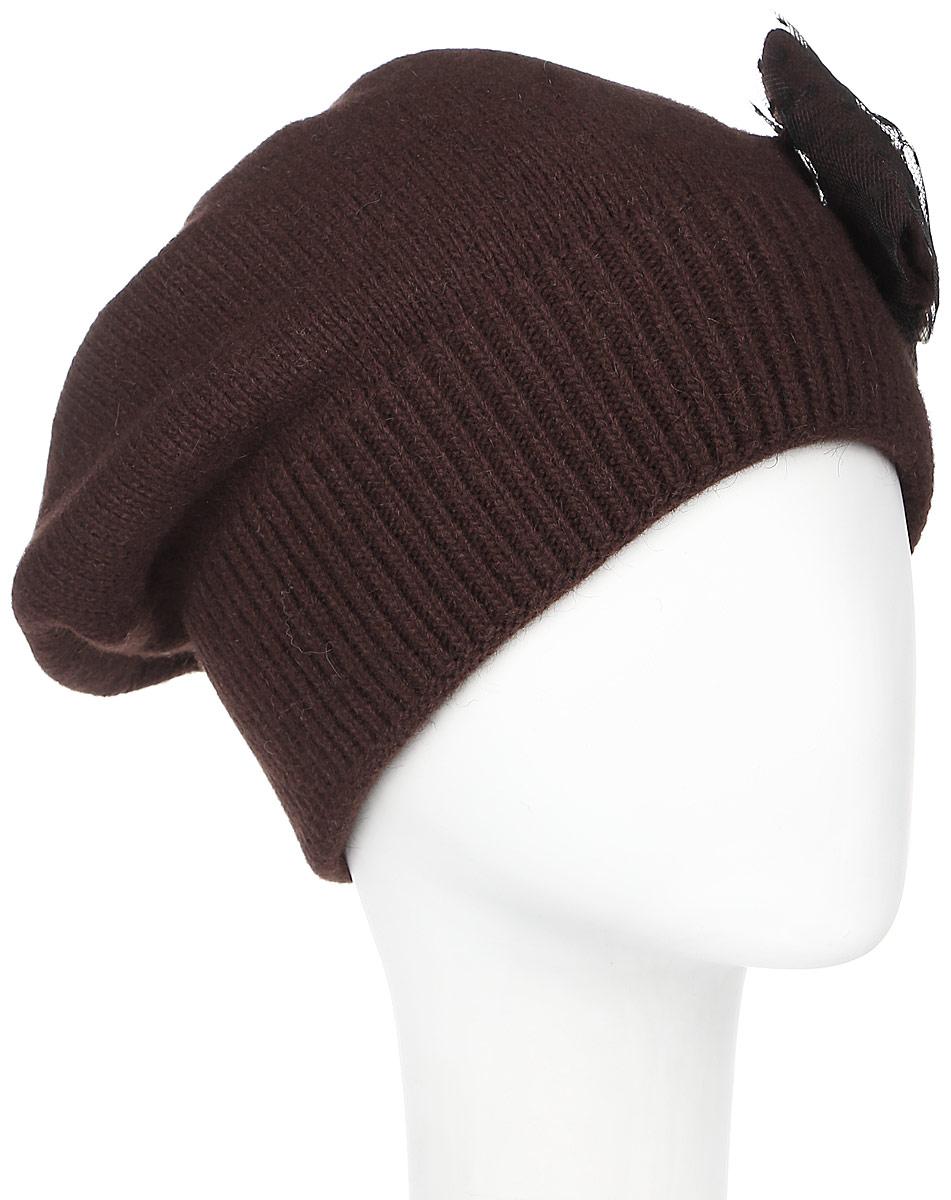 Шапка361881L-85Женская шапка Vittorio Richi выполнена из нейлона, вискозы и шерсти. Модель мелкой вязки, украшена бантом с крупной стразой, низ изделия оформлен вязаной резинкой. Уважаемые клиенты! Размер, доступный для заказа, является обхватом головы.