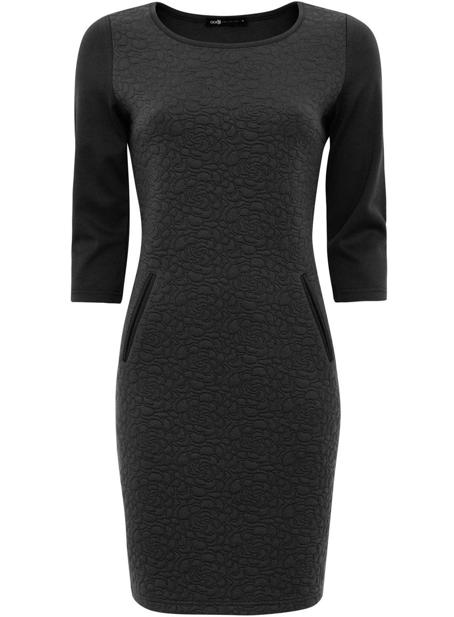 Платье24001100-1/42316/2900NСтильное платье oodji Collection, выполненное из качественного комбинированного материала, отлично дополнит ваш гардероб. Модель-миди с круглым вырезом горловины и стандартными рукавами 3/4 спереди оформлена декоративными прорезями под карманы.