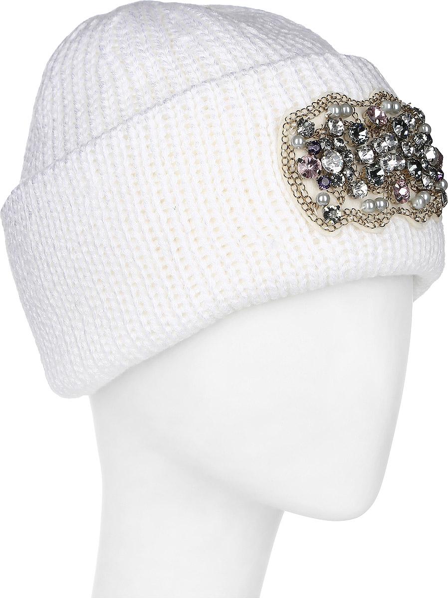 Шапка341741S-11Теплая женская шапка Vittorio Richi отлично дополнит ваш образ в холодную погоду. Сочетание шерсти и полиамида сохраняет тепло и обеспечивает удобную посадку, невероятную легкость и мягкость. Стильная шапка выполнена крупной вязкой и по низу дополнена большим отворотом. Отворот украшен небольшой аппликацией из различных жемчужин и страз. Модель составит идеальный комплект с модной верхней одеждой, в ней вам будет уютно и тепло. Уважаемые клиенты! Размер, доступный для заказа, является обхватом головы.