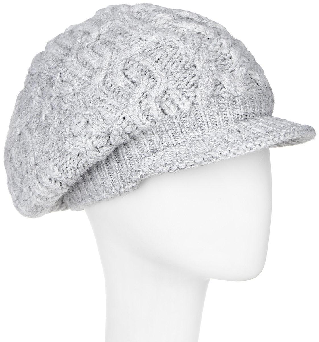 261923V-22Женская шапка Vittorio Richi выполнена из сочетания шерсти и акрила. Оформлена модель объемной вязкой и дополнена козырьком. Уважаемые клиенты! Размер, доступный для заказа, является обхватом головы.