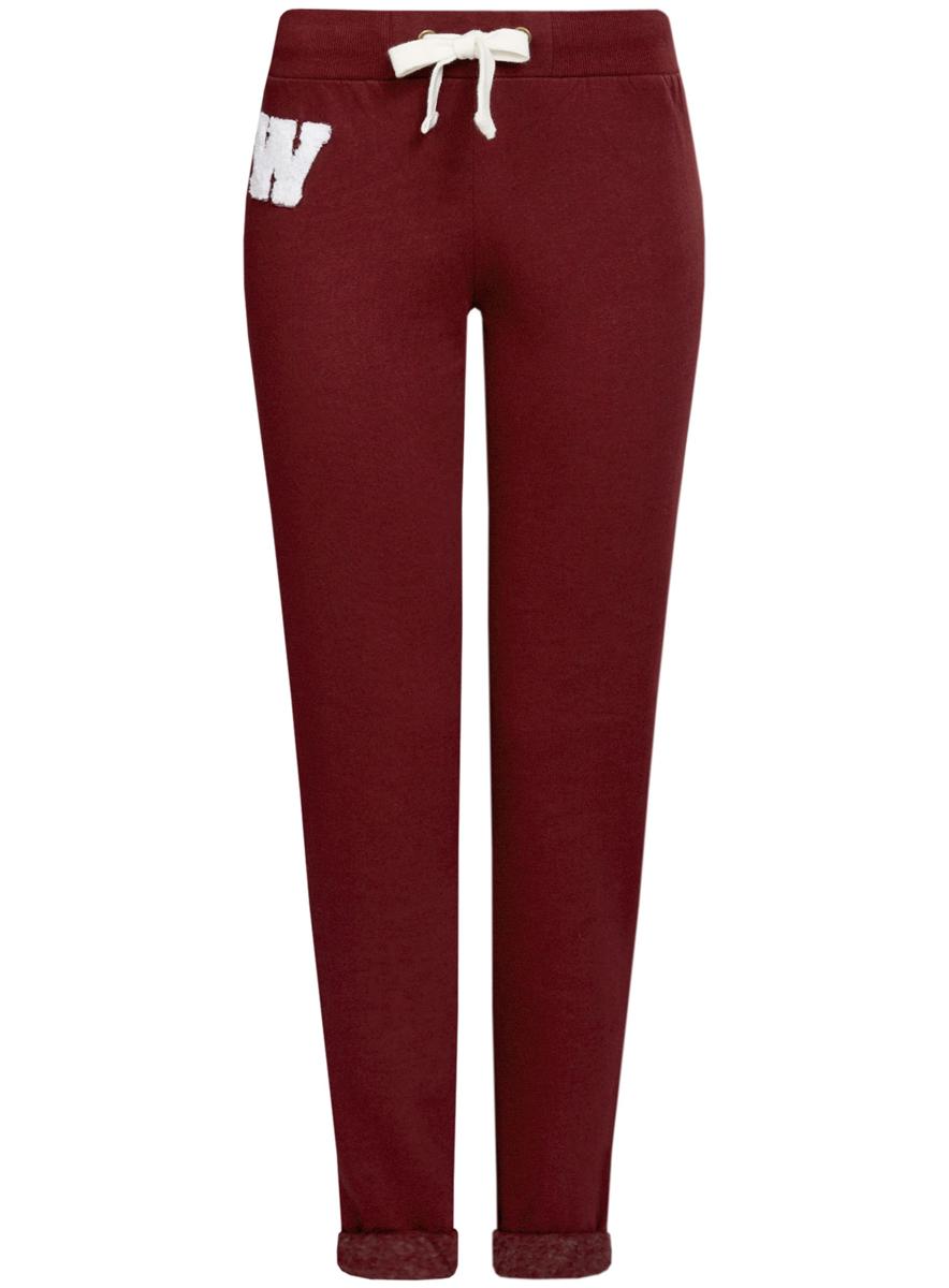16701010-2/43547/7910PСпортивные женские брюки oodji Ultra выполнены из натурального хлопка. Модель имеет широкую резинку на поясе, объем талии регулируется при помощи шнурка-кулиски. Сзади брюки дополнены имитацией прорезного кармана. Снизу брючины оснащены декоративными отворотами на резинках.