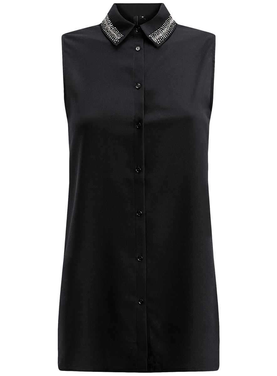 Блузка11411089/43848/2900NСтильная женская блузка oodji Ultra выполнена из качественного полиэстера. Модель без рукавов и с отложным воротником застегивается спереди на пуговицы. Блузка изготовлена из легкой, струящейся ткани и дополнена стильным декором на воротнике.