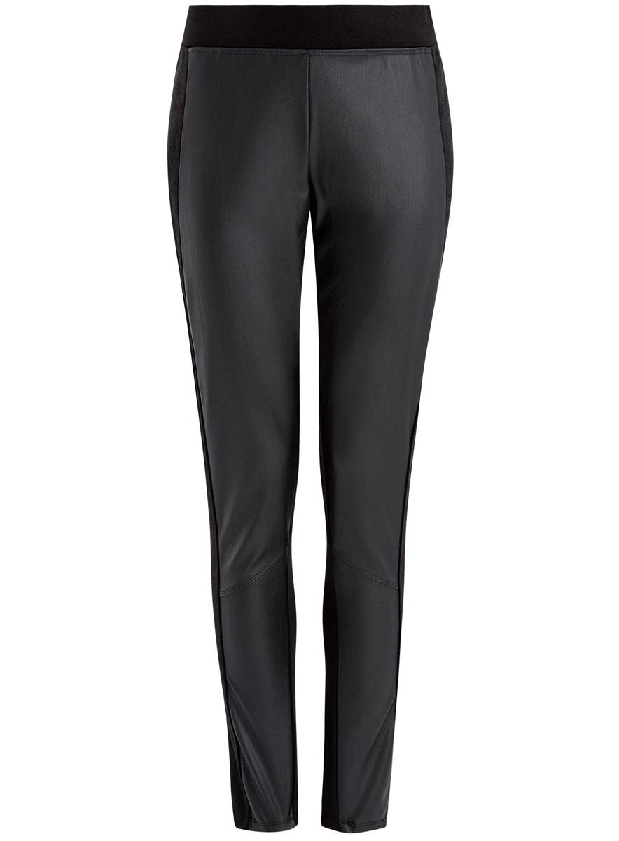 Брюки18702004/37854/2900NЖенские брюки-скинни oodji Ultra стандартной посадки изготовлены из полиэстера с добавлением вискозы и полиуретана. Брюки имеют широкую эластичную резинку на поясе и дополнены вставками.