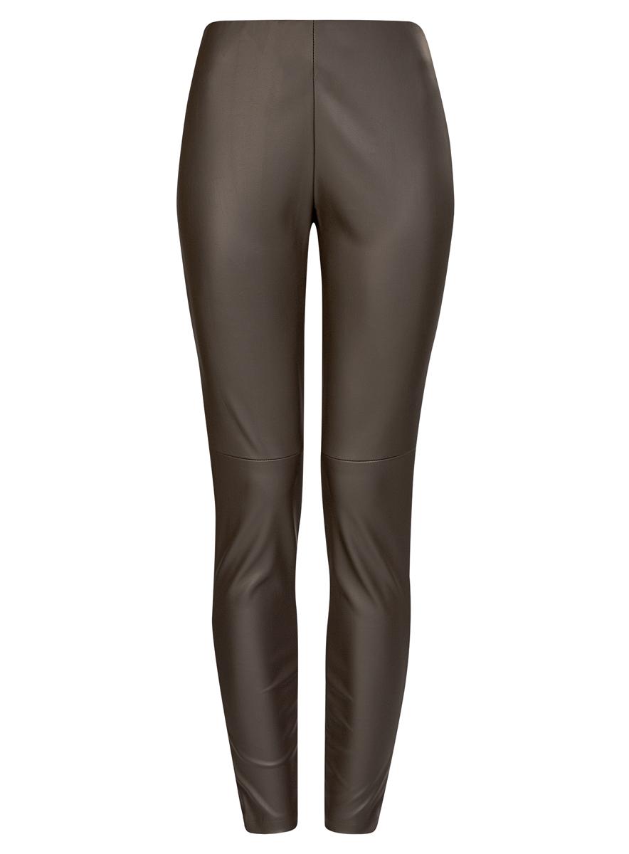 Брюки18G07001/45085/2900NСтильные женские брюки oodji Ultra выполнены из искусственной кожи. Модель на талии дополнена широкой эластичной резинкой, сбоку потайной застежкой-молнией. Брюки-скинни со средней линией талии. Низ брючин регулируется по ширине за счет молний.