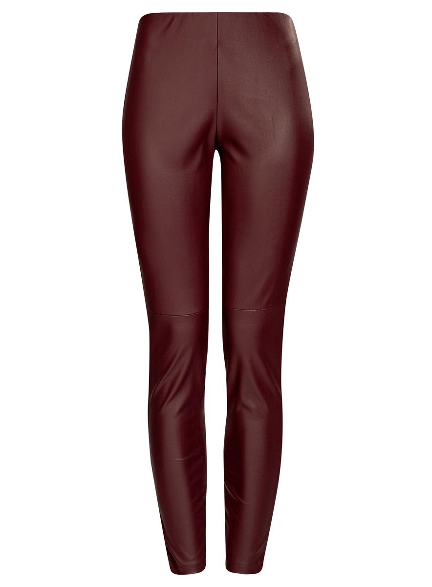 18G07001/45085/2900NСтильные женские брюки oodji Ultra выполнены из искусственной кожи. Модель на талии дополнена широкой эластичной резинкой, сбоку потайной застежкой-молнией. Брюки-скинни со средней линией талии. Низ брючин регулируется по ширине за счет молний.