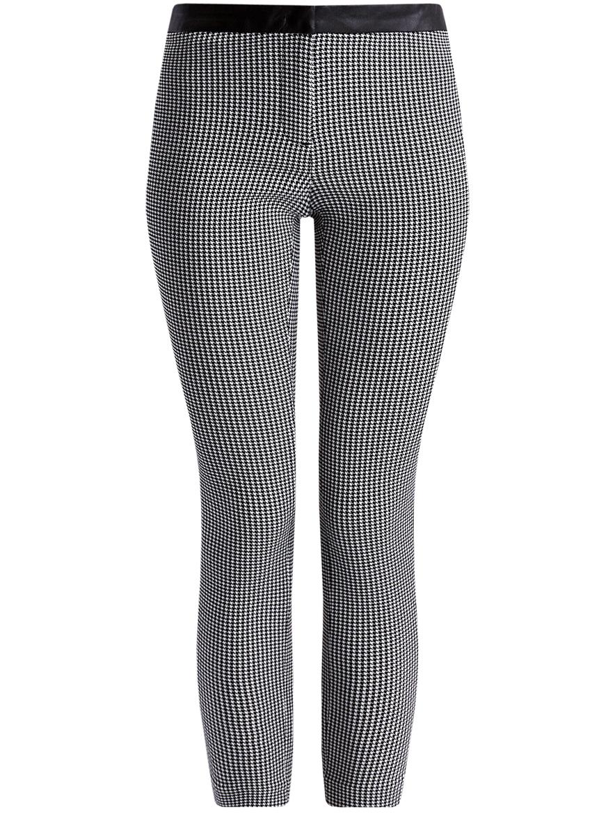 11706199/45685/1229GСтильные женские брюки oodji выполнены из комбинированного материала с отделкой из искусственной кожи. Модель со средней посадкой застегивается на молнию, пуговицу и застежку-крючок. Сзади изделие оформлено имитацией прорезных карманов.