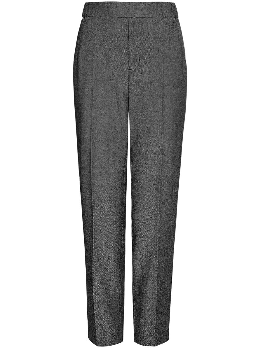 11703091-3/45962/1229JСтильные женские брюки oodji Ultra изготовлены из полиэстера с небольшим добавлением шерсти. Модель со средней посадкой в поясе выполнена на эластичной резинке и спереди оформлена декоративной ширинкой. По бокам изделие дополнено втачными карманами, сзади имитацией одного прорезного кармана.