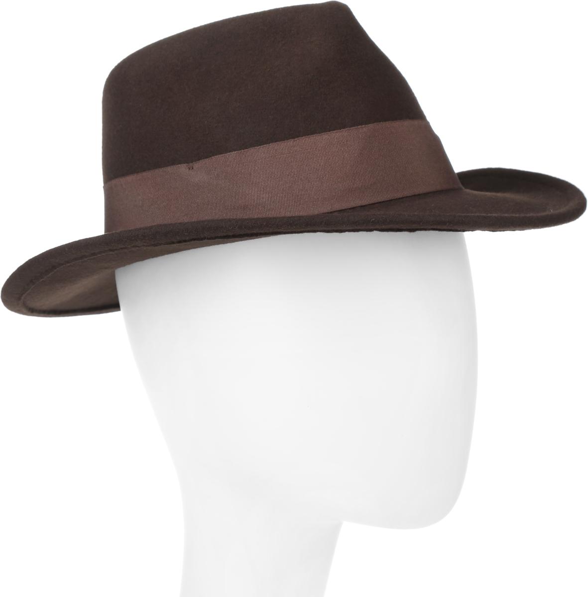 Шляпа600-0001Элегантная шляпа The Francis Fratelli от Goorin Brothers из коллекции Glory, выполненная из фетра, дополнит любой образ. Модель с узкими полями, невысокой вертикальной тульей с продольными заломами и прямым полями. Внутри модель дополнена плотной тесьмой для комфортной посадки изделия по голове. Шляпа-федора по тулье оформлена широкой текстильной лентой с перемычкой дополненной металлическим элементом в виде логотипа бренда. Такая шляпа подчеркнет вашу неповторимость и прекрасный вкус.