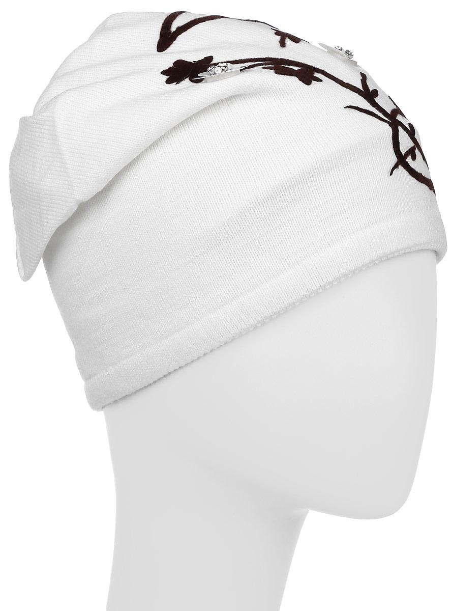 К060-22Шапка для девочки Concept, выполненная из акрила с добавлением хлопка, защитит от ветра в холодную погоду. Модель по низу дополнена эластичной резинкой. Сзади шапка украшена декоративной складкой. Оформлено изделие цветочной аппликацией, пайетками, бисером и искусственными камнями. Уважаемые клиенты! Размер, доступный для заказа, является обхватом головы.