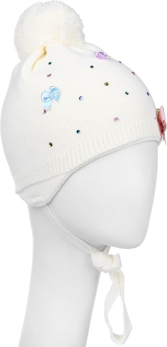 Шапка детскаяАнита-22Теплая шапка для девочки Oven выполнена из теплой шерсти с добавлением высококачественного акрила. Шапка оформлена атласными бантиками, металлической брошкой со стразами и декорирована блестящими стразами. На макушке модель оформлена пушистым помпоном. По бокам шапка дополнена удлиненными ушками с завязочками. Уважаемые клиенты! Размер, доступный для заказа, является обхватом головы.