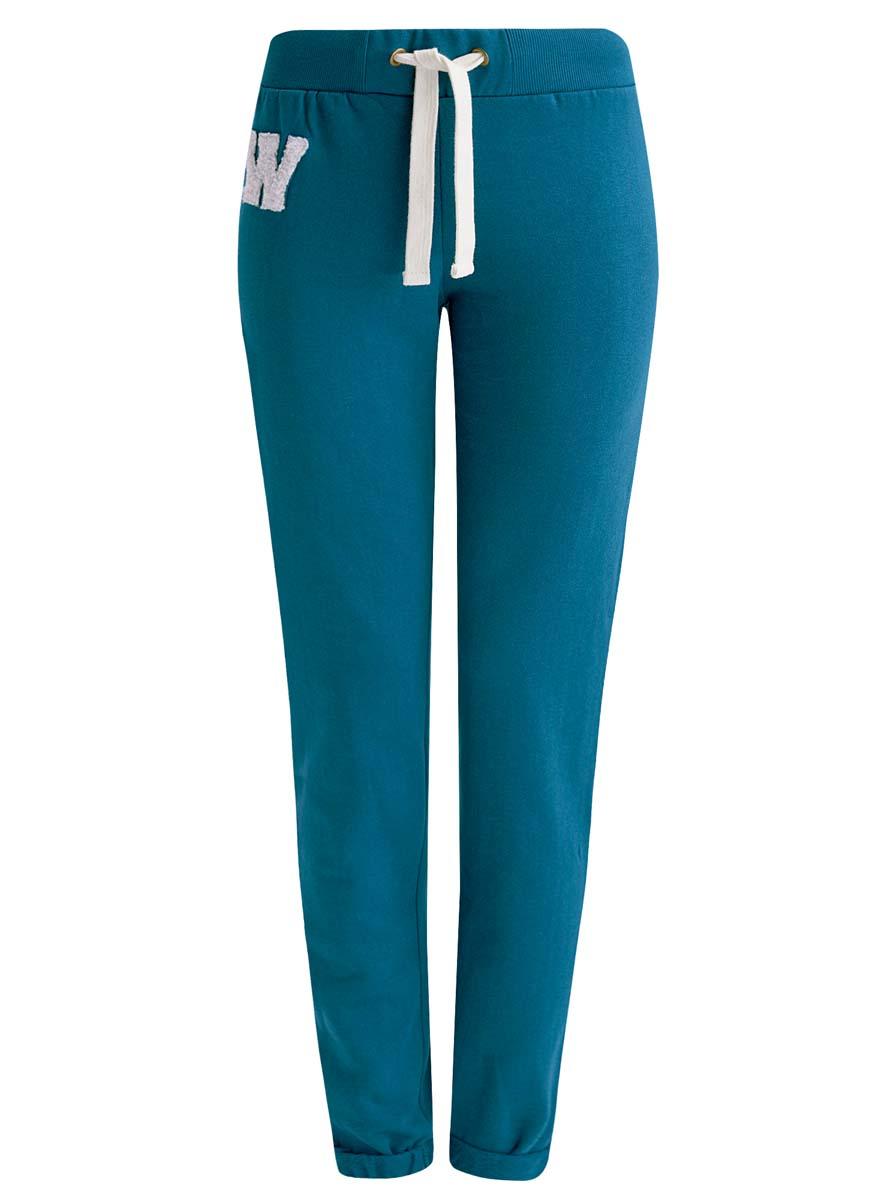 Брюки спортивные16701010-2/43547/7910PСпортивные женские брюки oodji Ultra выполнены из натурального хлопка. Модель имеет широкую резинку на поясе, объем талии регулируется при помощи шнурка-кулиски. Сзади брюки дополнены имитацией прорезного кармана. Снизу брючины оснащены декоративными отворотами на резинках.