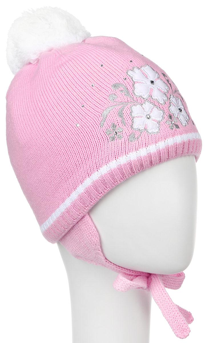 Шапка детскаяD3833-22Вязанная детская шапочка ПриКиндер станет отличным дополнением к детскому гардеробу. Верх изделия изготовлен из акрила с добавлением шерсти, а подкладка из качественного хлопка с добавлением лайкры, что обеспечивает тепло и комфорт. Благодаря эластичной вязке, шапка идеально прилегает к голове ребенка. Шапка оформлена цветочной аппликацией и декорирована стразами, на макушке модель имеет мягкий пушистый помпон. Изделие завязывается на шнурочки, пришитые сбоку к удлиненным ушкам, тем самым обеспечивает тепло в холодную погоду и защищает детские ушки от холода. Уважаемые клиенты! Размер, доступный для заказа, является обхватом головы.