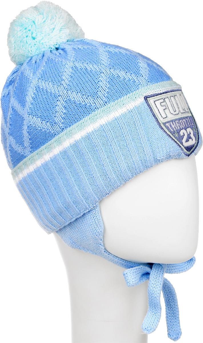 M3724-22Теплая шапка для мальчика ПриКиндер, выполненная из акрила с добавлением шерсти, защитит от ветров в холодную погоду. Подкладка изготовлена из хлопка с добавлением лайкры, утеплитель - ORSOTHERM. Модель с помпоном по низу связана резинкой и имеет отворот. По бокам шапка дополнена удлиненными ушками с завязками. Оформлено изделие вязаным узором и нашивкой. Уважаемые клиенты! Размер, доступный для заказа, является обхватом головы.