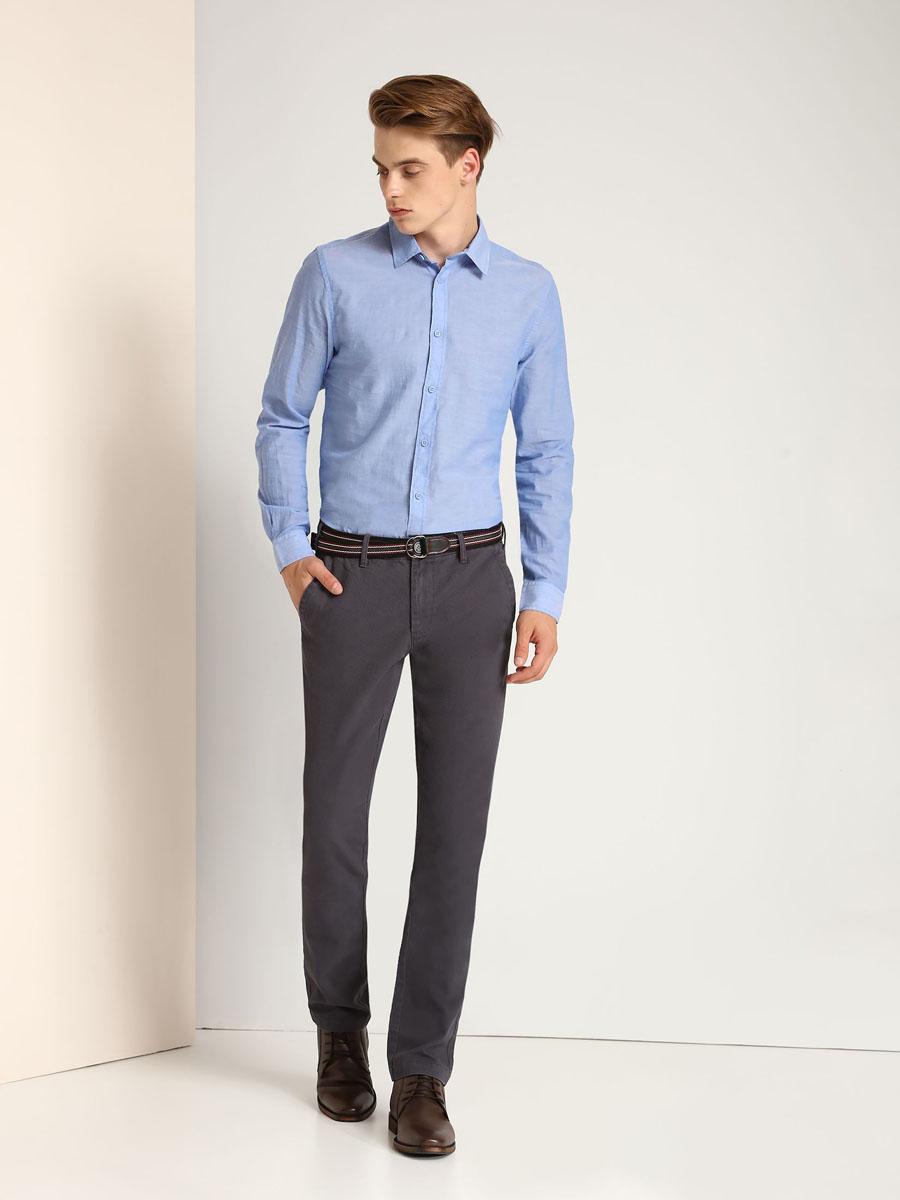 РубашкаSKL2113BLМужская рубашка Top Secret выполнена из натурального хлопка. Модель с отложным воротником и длинными рукавами застегивается на пуговицы по всей длине. Низ рукавов дополнен манжетами на пуговицах.