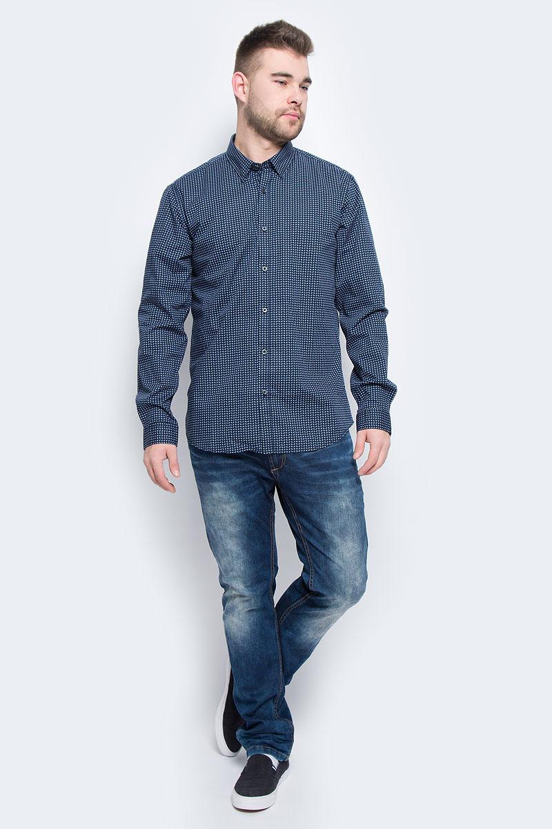 Рубашка20100443_563Мужская рубашка Broadway Rolla выполнена из эластичного хлопка. Рубашка с длинными рукавами и отложным воротником застегивается на пуговицы спереди. Манжеты рукавов также застегиваются на пуговицы. Модель оформлена мелким контрастным принтом.