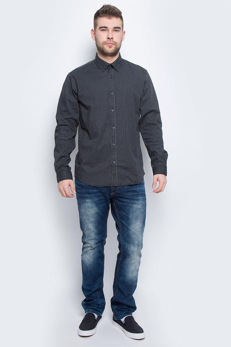 20100443_563Мужская рубашка Broadway Rolla выполнена из эластичного хлопка. Рубашка с длинными рукавами и отложным воротником застегивается на пуговицы спереди. Манжеты рукавов также застегиваются на пуговицы. Модель оформлена мелким контрастным принтом.