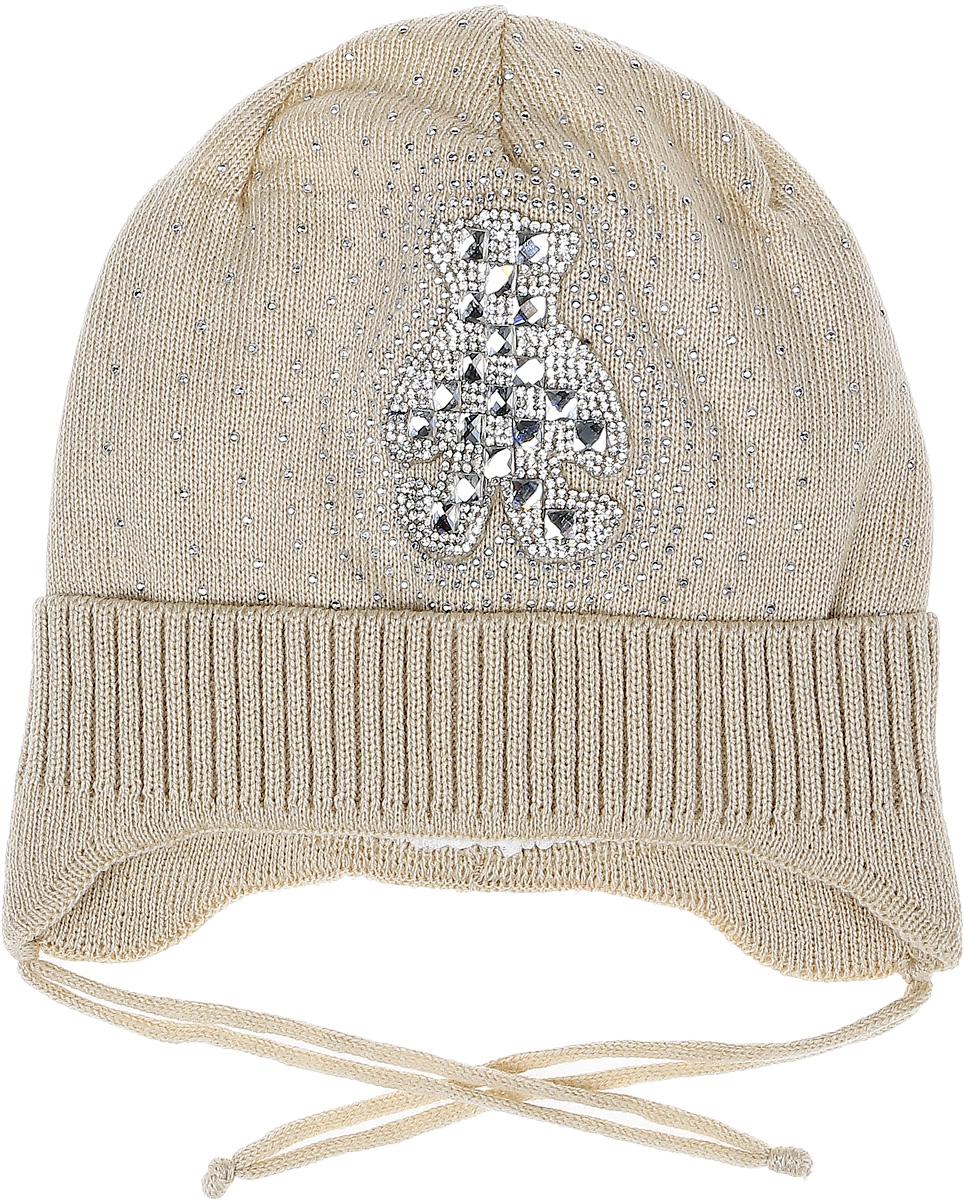 K034-22Стильная шапка для девочки InFante идеально подойдет для прогулок в прохладное время года. Изготовленная из хлопка, она обладает хорошими дышащими свойствами и хорошо удерживает тепло. Шапка декорирована аппликацией из страз. Модель дополнена отворотом. На ушках имеются завязки, с помощью которых шапку можно зафиксировать под подбородком. Такая шапка станет модным и стильным предметом детского гардероба. Уважаемые клиенты! Размер, доступный для заказа, является обхватом головы ребенка.