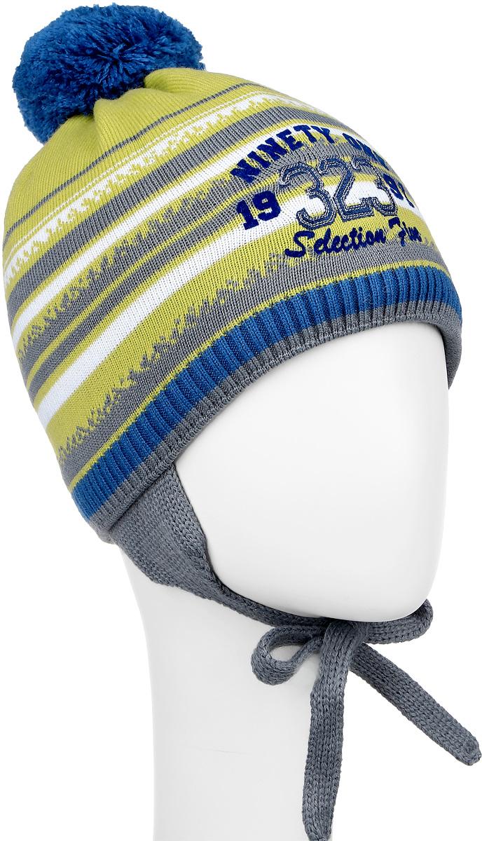 M3719-22Теплая детская шапка ПриКиндер отлично дополнит образ вашего ребенка в холодную погоду. Сочетание шерсти и акрила максимально сохраняет тепло и обеспечивает удобную посадку. Подкладка выполнена из натурального хлопка с добавлением лайкры. Шапка оформлена интересным принтом и надписями. По бокам модель немного удлинена и имеет завязки на шнурочках, а на макушке дополнена пушистым помпоном. Уважаемые клиенты! Размер, доступный для заказа, является обхватом головы.