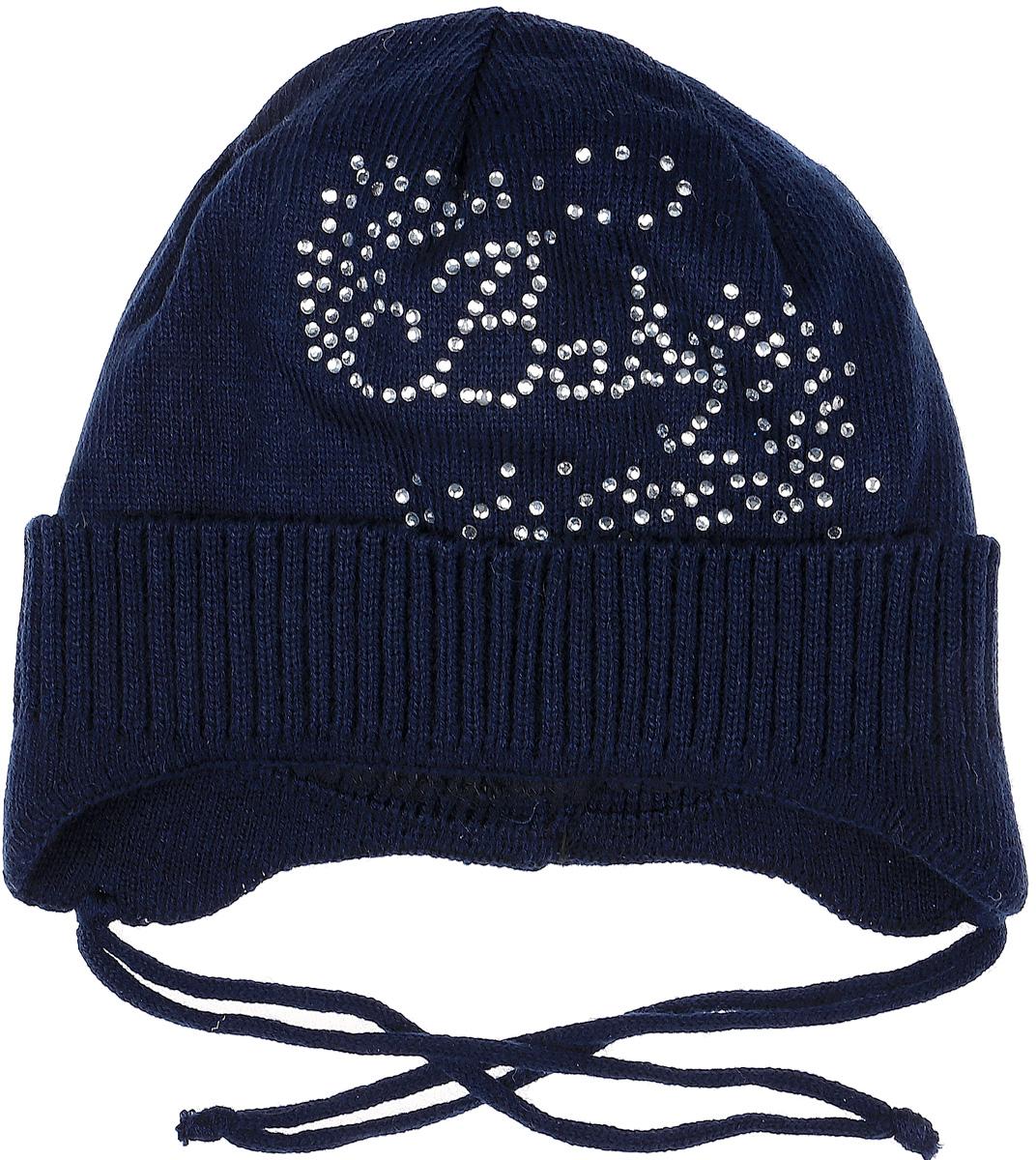 Шапка детскаяK035-22Теплая шапка для девочки InFante отлично дополнит образ в холодную погоду. Выполнена модель из натурального хлопка. Оформлено изделие аппликацией из стразов. По бокам модель немного удлинена и имеет завязки на шнурочках, а на макушке дополнена стразом. Уважаемые клиенты! Размер, доступный для заказа, является обхватом головы.