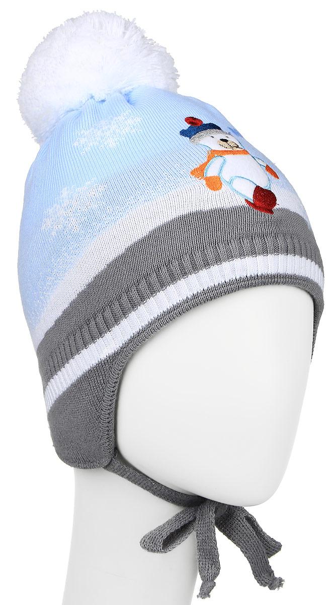 M2793-22Теплая шапка для мальчика ПриКиндер, выполненная из акрила с добавлением шерсти, защитит от ветров в холодную погоду. Подкладка изготовлена из хлопка с добавлением лайкры, утеплитель - ORSOTHERM. Модель с помпоном по низу связана резинкой. По бокам шапка дополнена удлиненными ушками с завязками. Оформлено изделие вязаным узором и нашивкой в виде мишки. Уважаемые клиенты! Размер, доступный для заказа, является обхватом головы.