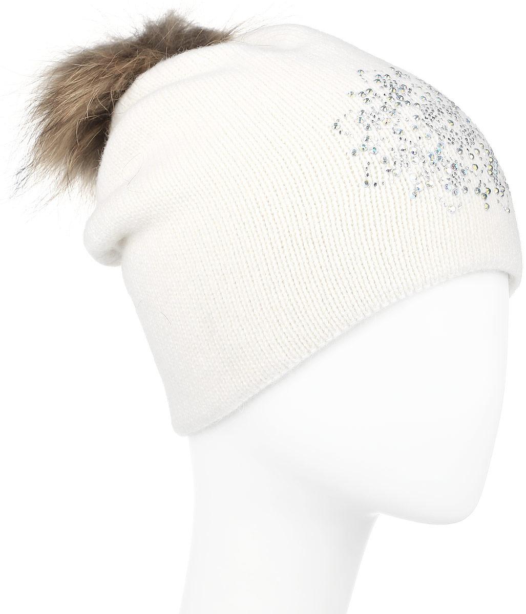 ШапкаW16-11128_323Стильная женская шапка Finn Flare дополнит ваш наряд и не позволит вам замерзнуть в холодное время года. Шапка выполнена из высококачественной пряжи, что позволяет ей великолепно сохранять тепло и обеспечивает высокую эластичность и удобство посадки. Модель оформлена брендовой металлической пластиной, стразами и дополнена помпоном из натурального меха. Уважаемые клиенты! Размер, доступный для заказа, является обхватом головы.
