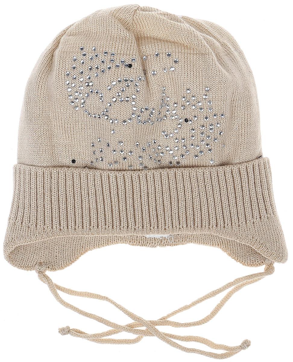 K035-22Теплая шапка для девочки InFante отлично дополнит образ в холодную погоду. Выполнена модель из натурального хлопка. Оформлено изделие аппликацией из стразов. По бокам модель немного удлинена и имеет завязки на шнурочках, а на макушке дополнена стразом. Уважаемые клиенты! Размер, доступный для заказа, является обхватом головы.
