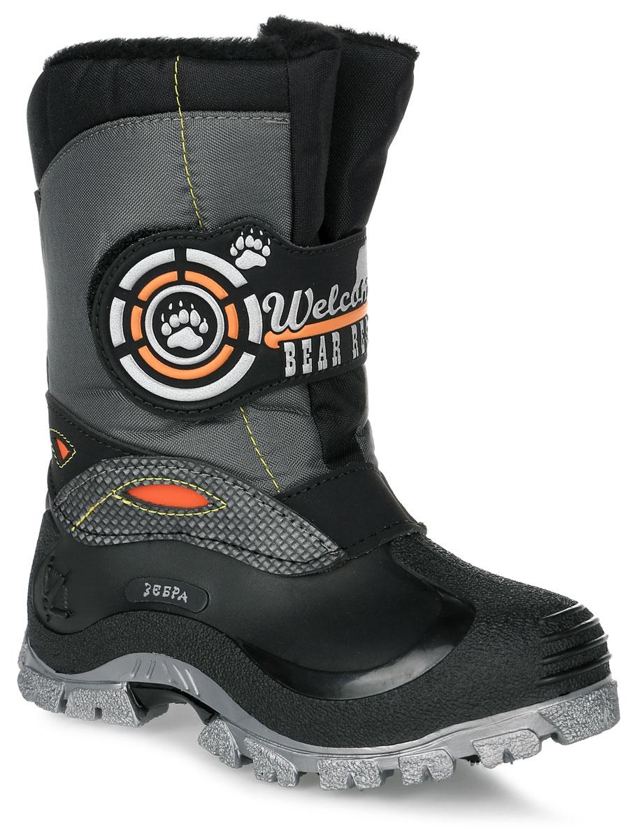 11139-1Теплые дутики Зебра выполнены из высококачественного текстиля, не пропускающего воду и ПВХ. Модель оформлена нашивками и декоративной прострочкой. Хлястик с застежкой-липучкой позволит отрегулировать объем голенища и надежно зафиксирует обувь на ноге. Подкладка и стелька из натуральной шерсти обеспечат тепло и комфорт. Подошва изготовлена из гибкого и прочного ПВХ и оснащена протектором, который гарантирует отличное сцепление с любой поверхностью.