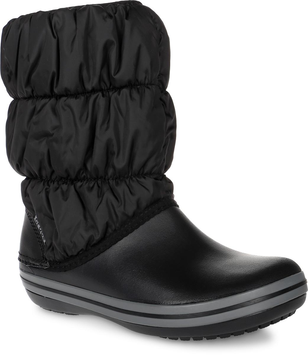 14614-070Дутики Crocs Winter Puff Boot выполнены из полимерного материала и высококачественного текстиля, не пропускающего воду. Модель оформлена декоративной прострочкой. Эластичная резинка надежно зафиксирует модель на ноге. Внутренняя поверхность и стелька выполнены из утепленного текстиля, комфортного при движении. Подошва изготовлена из полимерного материала и дополнена протектором, который гарантирует отличное сцепление с любой поверхностью.