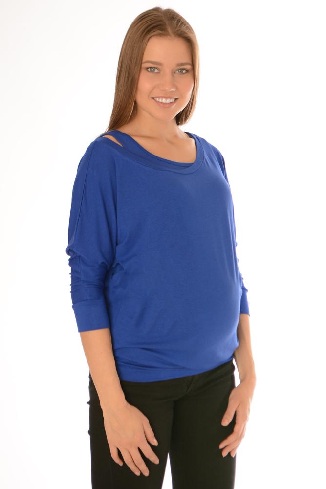 Блузка221.1Стильная, яркая, удобная блуза для будущих и кормящих мам Ням-Ням с рукавами 3/4, изготовленная из эластичной вискозы, женственна и элегантна. Блуза на широком поясе с рукавом летучая мышь позволит выглядеть очаровательно в любой день. Рукава дополнены широкими манжетами. Для удобства кормления в комплекте идет короткий топ-майка, который, при желании, можно использовать отдельно от блузы. Эту модель можно носить во время беременности и после родов. Вискоза является волокном, произведенным из натурального материала - целлюлозы (древесины). Иногда ее называют древесный шелк. Эта ткань на ощупь мягкая и приятная, образует красивые складки. Материал очень хорошо впитывает влагу, не образует катышек со временем, не выцветает на солнце и обладает приятным шелковистым блеском.