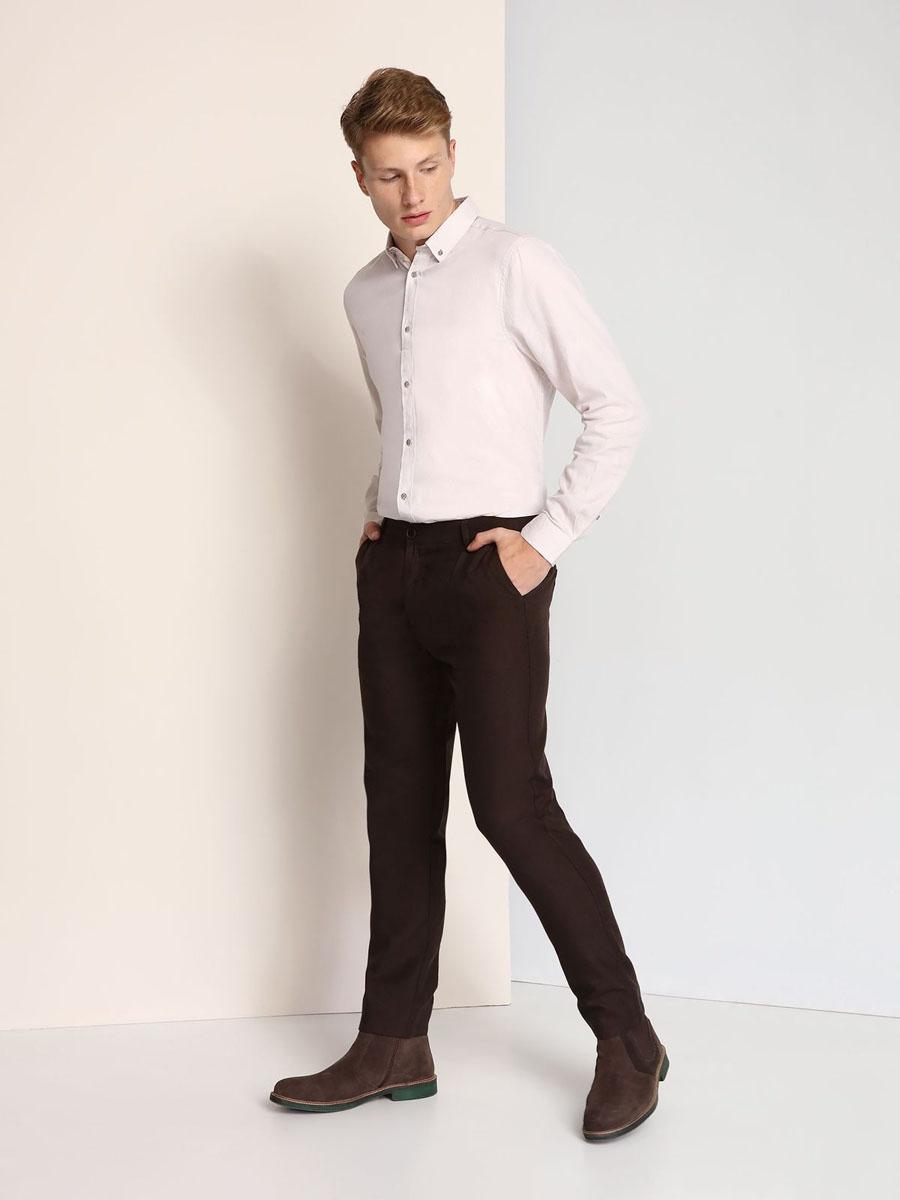 РубашкаSKL2115BEМужская рубашка Top Secret выполнена из натурального хлопка. Модель с отложным воротником и длинными рукавами застегивается на пуговицы по всей длине. Низ рукавов дополнен манжетами на пуговицах.