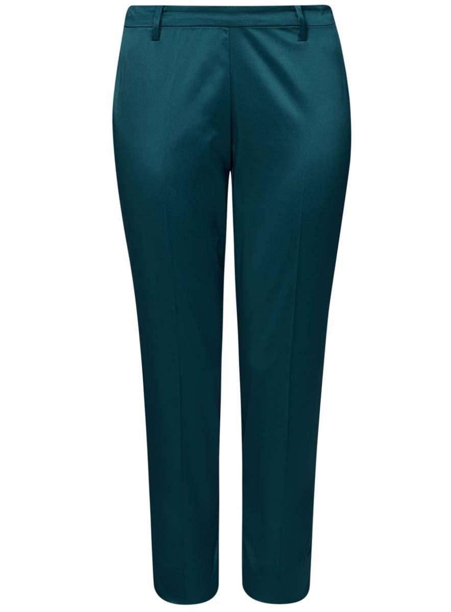 21706022-2/32700/2900NСтильные женские брюки oodji Collection изготовлены из качественного комбинированного материала. Модель зауженного кроя со стандартной посадкой выполнена в лаконичном стиле и по низу брючин оформлена небольшими разрезами. Застегиваются брюки по боковому шву на застежку-молнию и потайную пуговицу в поясе. Сзади изделие оформлено прорезным карманом-обманкой, а в поясе имеет шлевки для ремня.