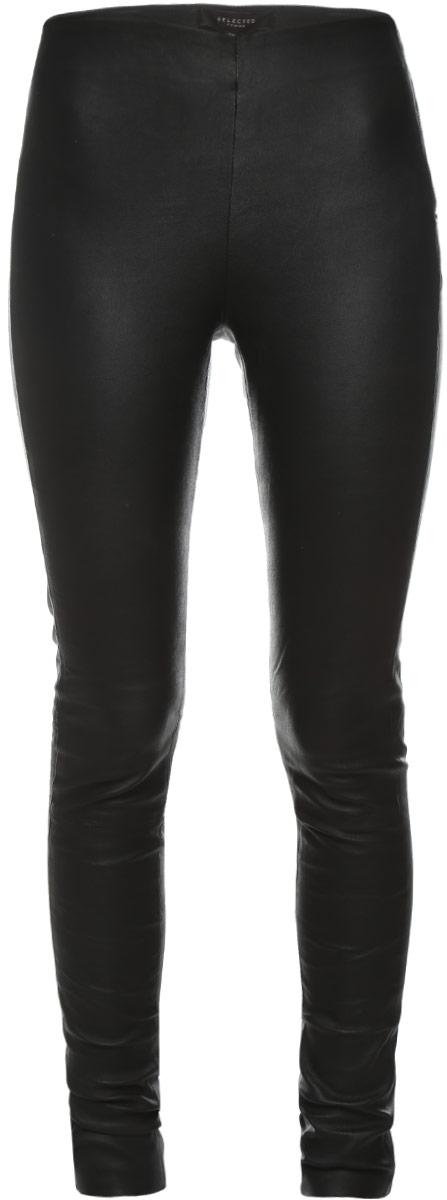 Брюки16054544_BlackСтильные женские брюки Selected Femme, выполненные из материала высочайшего качества: овчинной кожи. Модель-скинни стандартной посадки и зауженного кроя сбоку застегивается на застежку-молнию, а также на одну кнопку.