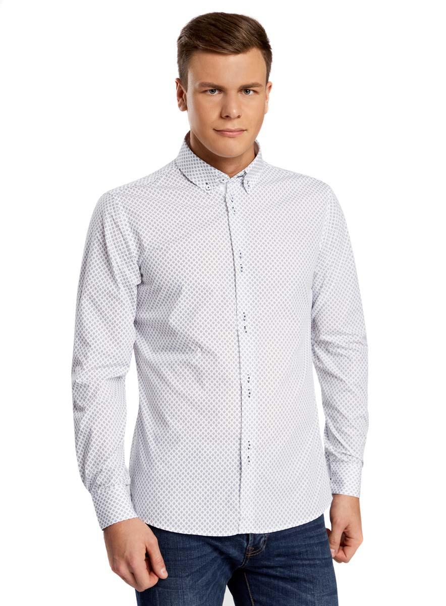 Рубашка3L110209M/19370N/1079GСтильная мужская рубашка oodji выполнена из натурального хлопка. Модель с отложным воротником и длинными рукавами застегивается на пуговицы спереди. Манжеты рукавов дополнены застежками-пуговицами. Оформлена рубашка контрастным принтом.