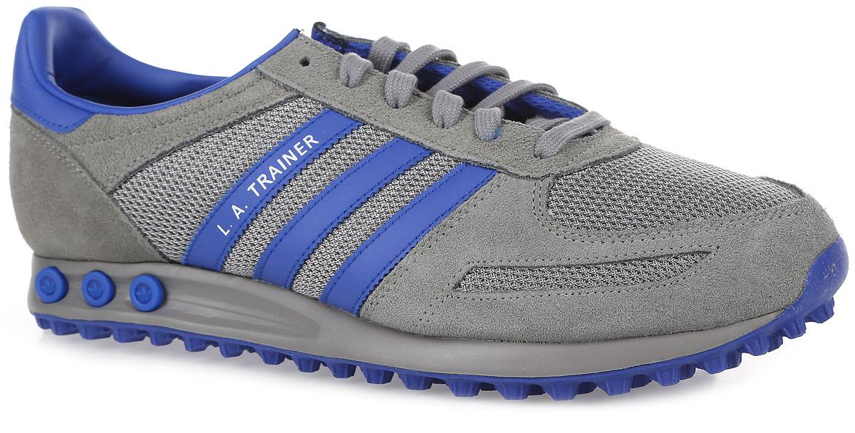 КроссовкиS76060Прошли десятилетия с дебюта кроссовок LA Trainer от adidas Originals, но они до сих пор вызывают восхищение. Эта версия является переизданием оригинальной модели 1981 года. Аутентичный верх из натуральной замши и сетки дополнен контрастными деталями. Три вынимаемые вставки-колышки позволяют регулировать уровень амортизации. Стелька из EVA с текстильной поверхностью комфортна при движении в течение всего дня. Литая промежуточная подошва из материала EVA обладает высокой износостойкостью и обеспечивает идеальную амортизацию. Зубчатая резиновая подошва с протектором гарантирует идеальное сцепление с любыми поверхностями. Классическая шнуровка надежно фиксирует модель на ноге.