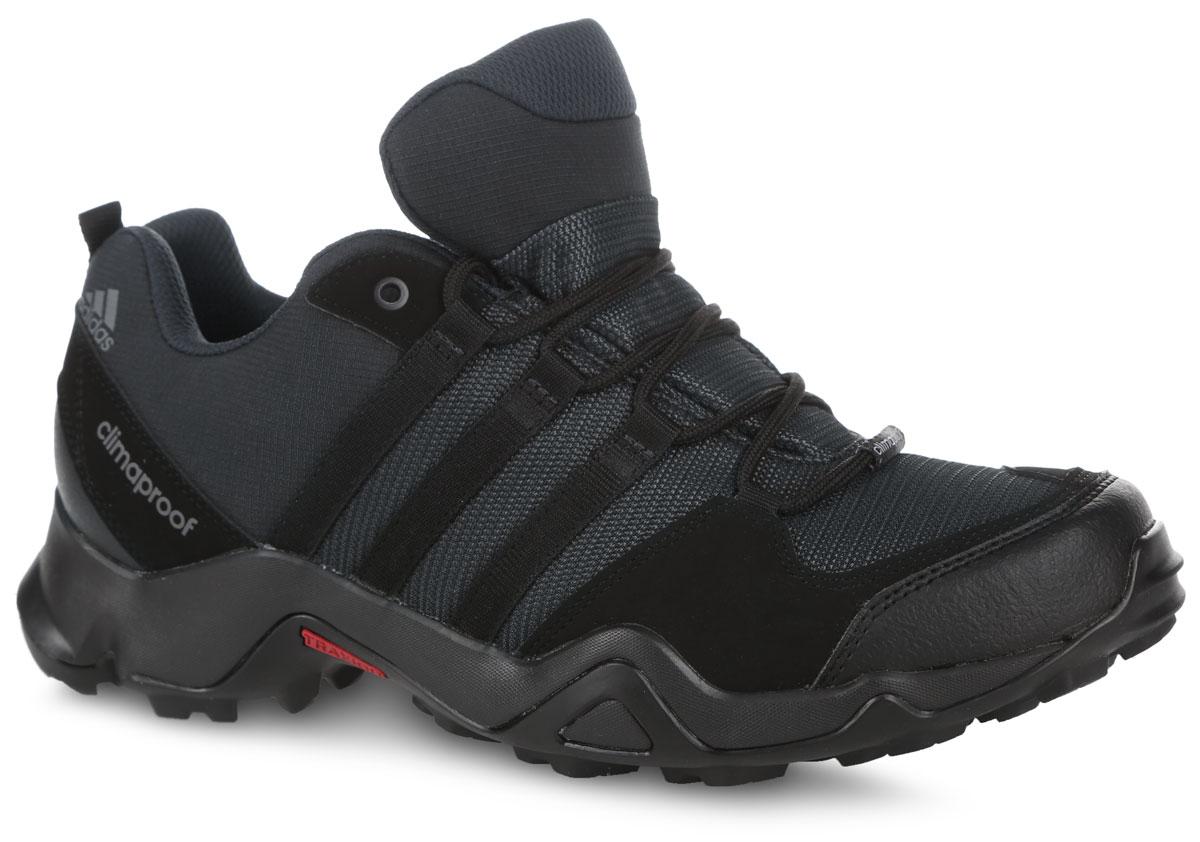 BA9253Мужские кроссовки AX2 CP от adidas - универсальная трекинговая обувь для простых пеших маршрутов и повседневной носки. Надежный гибкий верх выполнен из текстиля и дополнен бамперами на мыске и на пятке для дополнительной защиты стопы. Цепкая подошва с тракторным профилем Traxion поможет сохранить уверенность даже на скользких покрытиях. Удобная текстильная подкладка и литая анатомическая стелька с антимикробным покрытием обеспечивают наибольший комфорт. Классическая шнуровка надежно зафиксирует модель на ноге.