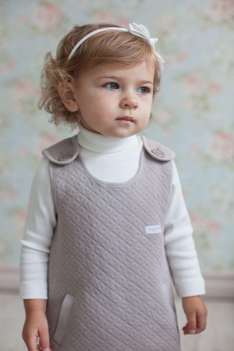 Водолазка33-23Мягкие и теплые водолазки от Lucky Child легко комбинировать с любой деталью гардероба. Цветовая гамма представлена в красивом бежевом и молочно-белом оттенках. Горловина не сдавливает шею, а защищает горло от холода. Подберите в комплект платье без рукавов или юбочку из коллекции Дуэт.