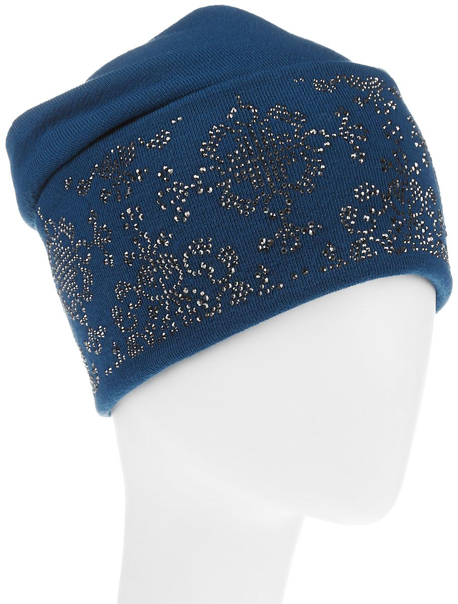 Шапка383671Стильная женская шапка Level Pro дополнит ваш наряд и не позволит вам замерзнуть в холодное время года. Шапка выполнена из шерсти и полиэстера, что позволяет ей великолепно сохранять тепло, и обеспечивает высокую эластичность и удобство посадки. Низ изделия дополнен широким отворотом оформленным оригинальным принтом выложенным из страз Такая шапка составит идеальный комплект с модной верхней одеждой, в ней вам будет уютно и тепло.