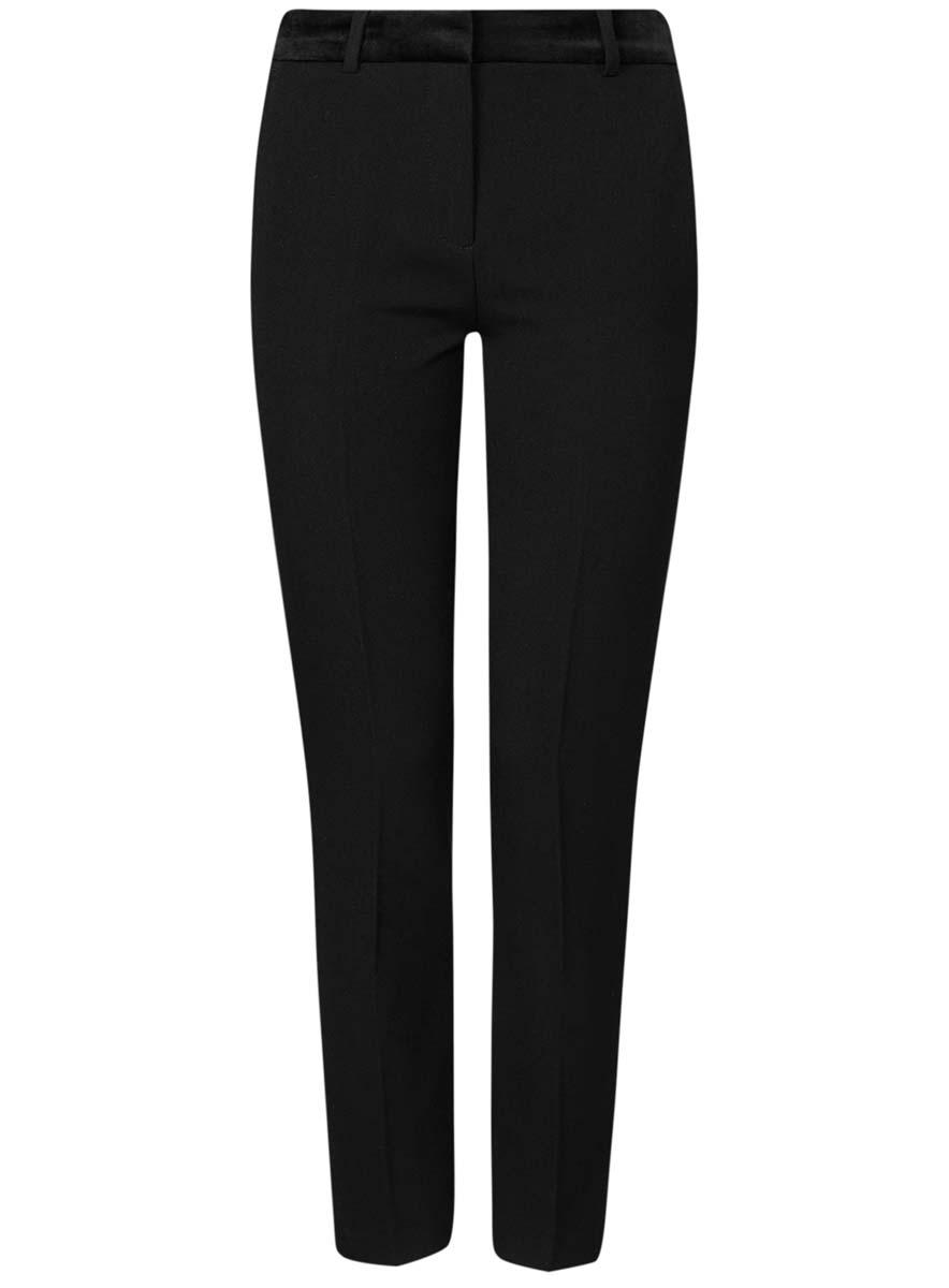 Брюки11706202/22434/2900NСтильные женские брюки oodji выполнены из комбинированного материала. Модель со средней посадкой застегивается на молнию, пуговицу и застежку-крючок, имеются шлевки для ремня. Сзади изделие оформлено имитацией прорезных карманов, спереди дополнены двумя втачными карманами.