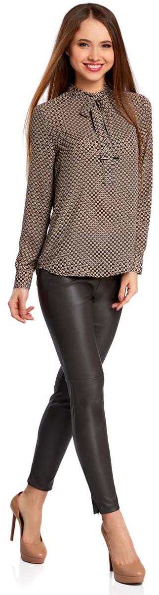 Блузка21411094/36215/7975GЖенская блузка oodji Collection исполнена из легкой ткани свободного кроя. Блузка имеет длинные рукава и воротник-аскот. Застегивается спереди и на манжетах на пуговицы. Блузка оформлена металлической фурнитурой на манжетах, воротнике и концах завязок.