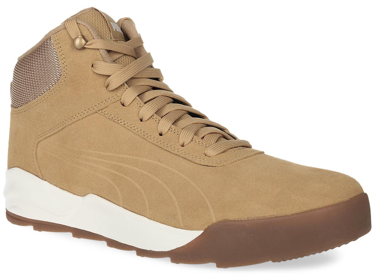 Ботинки36122001Новая модель Desierto Sneaker - это комфорт мягких кроссовок в сочетании с прочностью и надежностью зимних ботинок. Она выполнена из замши и снабжена упругой и эластичной промежуточной подошвой из вспененного этиленвинилацетата. Мощная ребристая внешняя подошва обеспечивает отличное сцепление с поверхностью. Среди других зимних элементов следует отметить обтачку голенища плотной тканью, стильную систему шнуровки, характерную для туристских ботинок, а также мягкую, теплую и уютную подкладку. Ботинки оформлены эмблемой Puma Formstrip с обеих сторон, а также фирменным логотипом Puma - на язычке. Desierto Sneaker - лучший выбор для тех, кому нужна функциональная и долговечная обувь на зимний период, которая выглядела бы стильно и современно!
