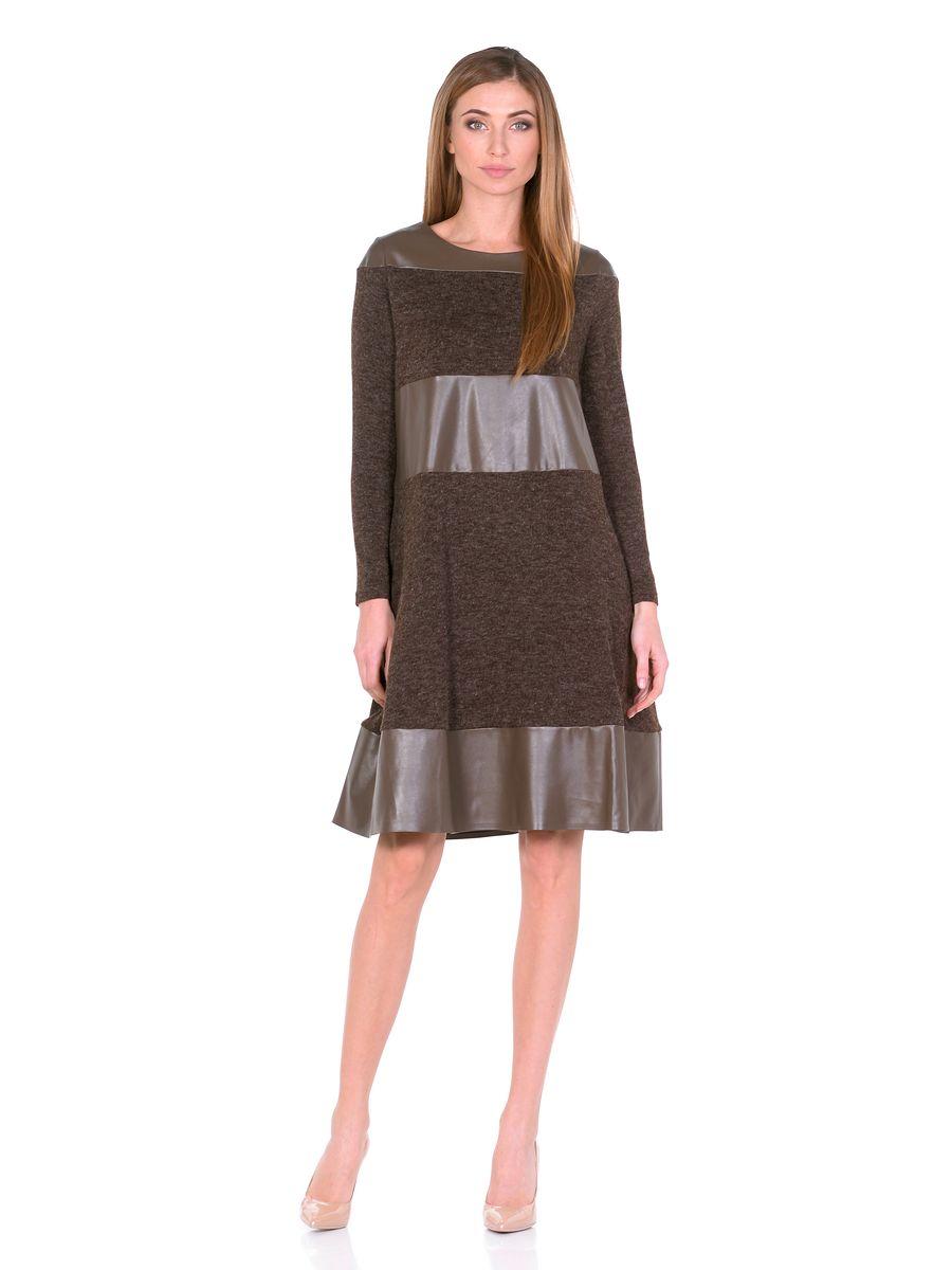 Платье14670-1Платье La Via Estelar выполнено из полиэстера, вискозы и эластана. Модель-миди с круглым вырезом горловины и длинным рукавом оформлена вставками из искусственной кожи. По бокам расположены втачные карманы.