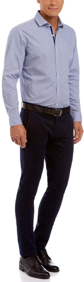 Рубашка3L110191M/19370N/1075GСтильная мужская рубашка oodji Lab выполнена из натурального хлопка. Модель с отложным воротником и длинными рукавами застегивается на пуговицы спереди. Манжеты рукавов дополнены застежками-пуговицами. Оформлена рубашка мелким контрастным принтом.