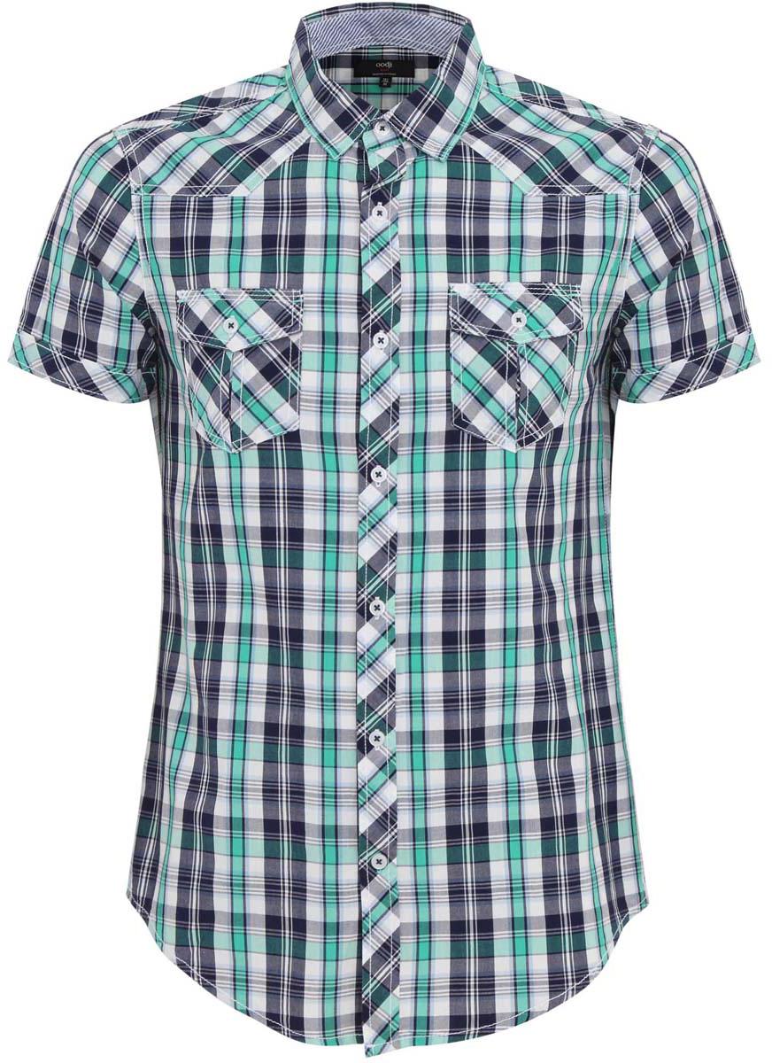Рубашка3L410041M/39311N/7965CСтильная мужская рубашка oodji Lab выполнена из натурального хлопка. Модель с отложным воротником и длинными рукавами застегивается на пуговицы спереди. Оформлена рубашка модным принтом в клетку и дополнена спереди двумя накладными карманами.