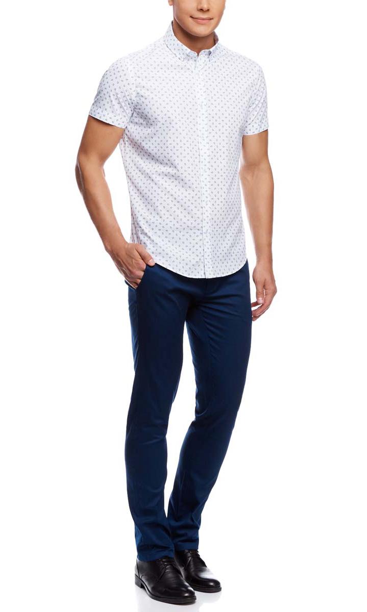 Рубашка3L210036M/19370N/1079EМужская рубашка oodji выполнена из натурального хлопка. Рубашка с короткими рукавами и отложным воротником застегивается на пуговицы спереди. Оформлена модель оригинальным принтом.
