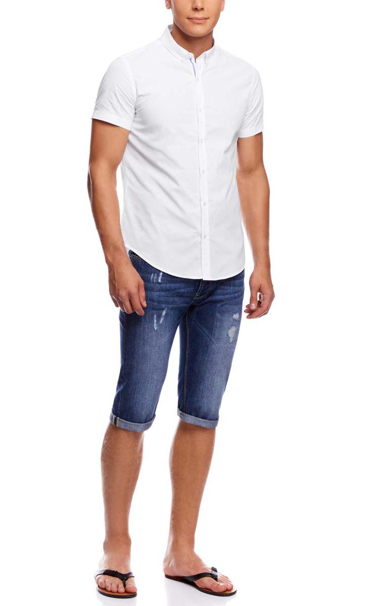 3L210032M/44263N/1000OМужская рубашка oodji из натурального хлопка имеет короткие рукава, застегивается на пуговицы спереди. На лацканах и сзади воротничка так же имеются пуговицы. Две запасные подшиты с обратной стороны полы.