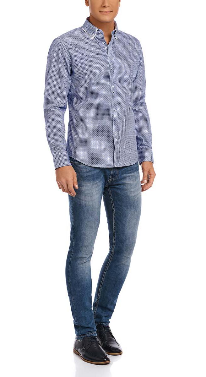 Рубашка3L110188M/19370N/1075GМужская рубашка oodji из натурального хлопка скроена по классическому силуэту и плотно садится по фигуре. Имеет двуслойный воротничок, длинные рукава, застегивается на пуговицы спереди и на манжетах. Две запасные пуговицы подшиты с обратной стороны полы.