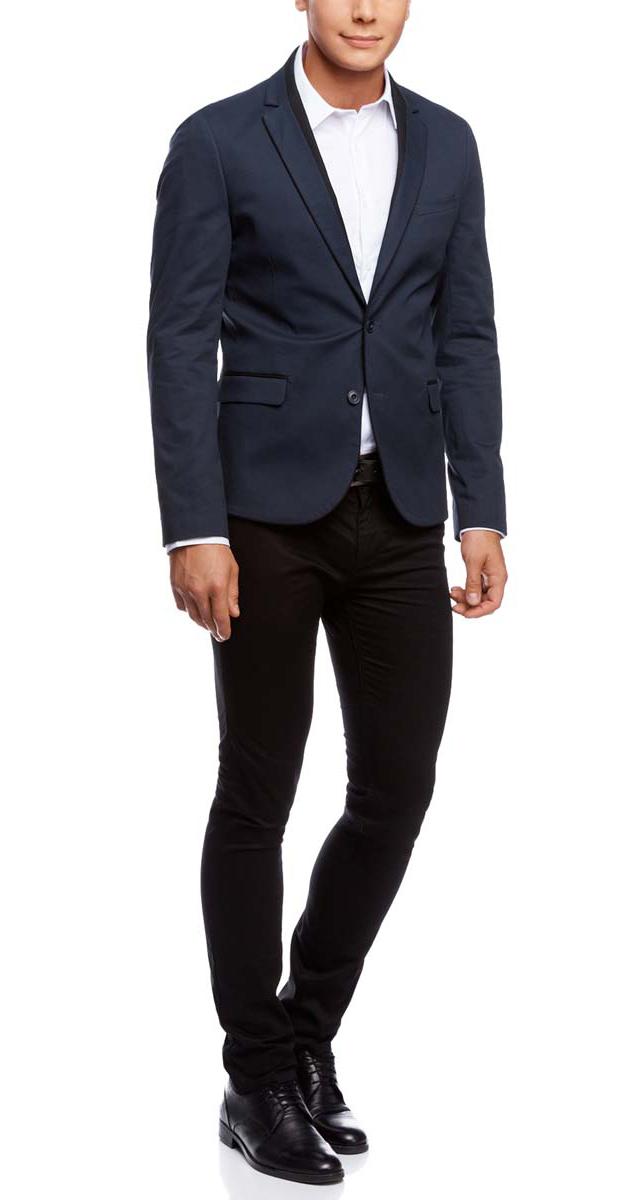 Пиджак2L420159M/39254N/7929BМужской пиджак oodji скроен по классическому силуэту и плотно садится по фигуре. Имеет длинные рукава, воротник с лацканами и карман слева на груди, два кармана по бокам от талии. Застегивается на пуговицы спереди и на манжетах. Сзади имеется шлица. Оформлен вставками из контрастной ткани.