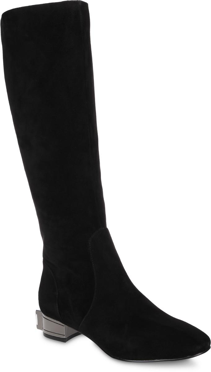91-183-40-5Стильные женские сапоги от Paolo Conte выполнены из натурального велюра. Подкладка и стелька выполнены из байки. Застегивается модель на боковую застежку-молнию. Эластичные вставки на голенище обеспечивают идеальную посадку модели на ноге. Невысокий каблук оформлен вставкой под металл и украшен крупным искусственным камнем. Подошва и каблук дополнены рифлением.